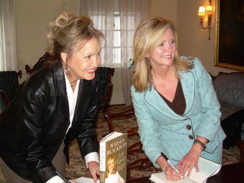Congresswoman Marsha Blackburn exchanging books.
